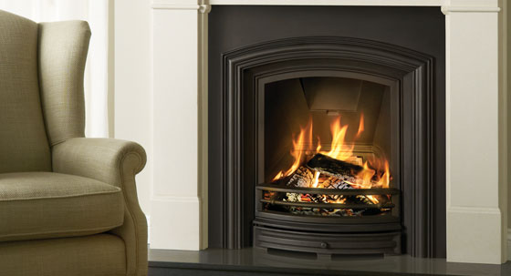 Alexandra Fireplace Insert in matt black, shown in Claremont Limestone Mantel