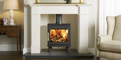 Nordpeis Wood Burning Stove shown in Claremont Limestone Mantel from Stovax