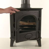 Leave the door slightly open when lighting a wood burning stove