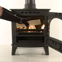add larger pieces of wood when lighting a wood burning stove