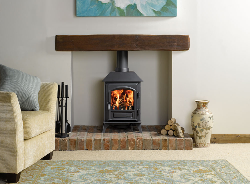 Riva plus small wood burning stoves multi fuel stoves for Small den with fireplace