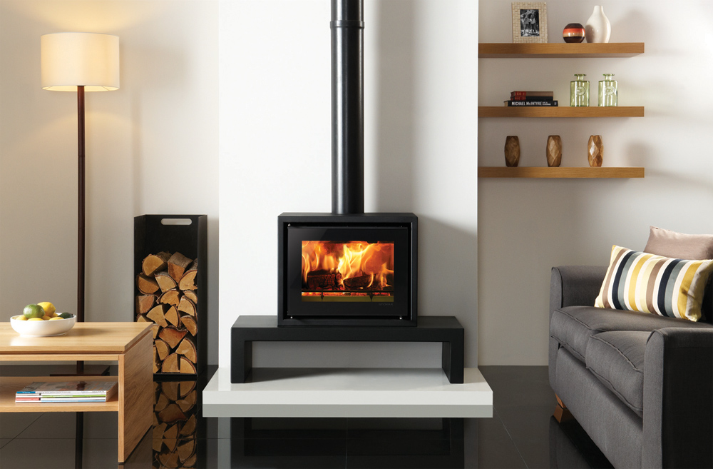 Stovax Studio 500 Freestanding wood burning stove on a 100 Low Riva Bench.  Also shown: Medium log holder also available from Stovax. - Studio 500 Freestanding Wood Burning Stove - Stovax Stoves