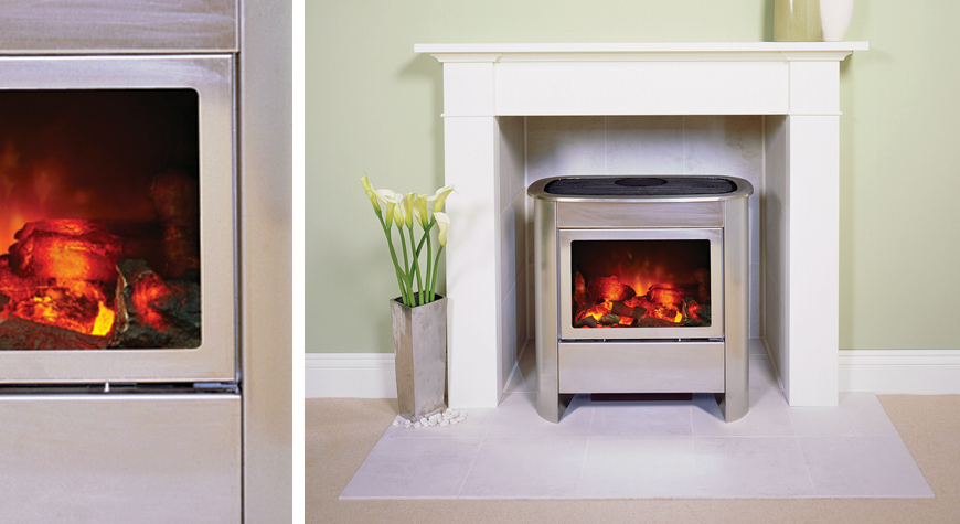 Electric Wood Burner Part - 16: Gazco Medium Steel Manhattan Electric Stove In Brushed Stainless Steel.  Also Shown: Brompton Wooden Mantel In White From Stovax.